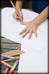 Child drawing his hands